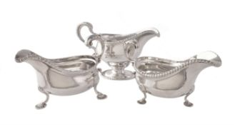 The silver oval sauce boats with gadrooned rims