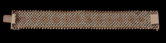 A 1960s 9 carat gold broad bracelet