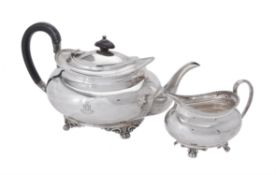 A silver oblong baluster tea pot and cream jug by Atkin Brothers