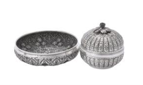 A middle eastern silver coloured circular bowl