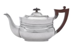 A late Victorian silver oblong baluster tea pot by Edward Barnard & Sons Ltd.