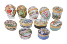 A collection of enamel boxes and eggs by Halcyon Days