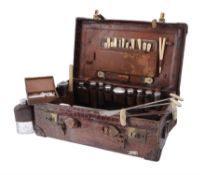 Y Asprey, a brown crocodile travel case