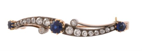 An antique sapphire and diamond crossover brooch