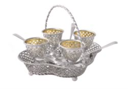 A Victorian silver quatrefoil four cup egg stand by Henry Wilkinson & Co.