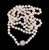An opera length cultured pearl necklace with diamond and pearl clasp