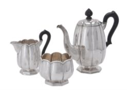 A German silver three piece lobed tea set by J. Demessieur