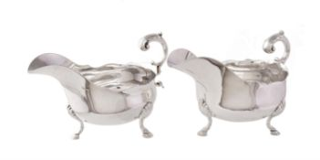 A matched pair of silver oval sauce boats by Atkin Brothers