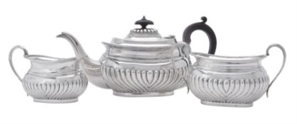 A late Victorian silver three piece oblong baluster tea set by Samuel Walton Smith
