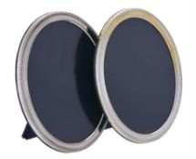 A matched pair of silver mounted oval photo frames by Carr's of Sheffield Ltd.