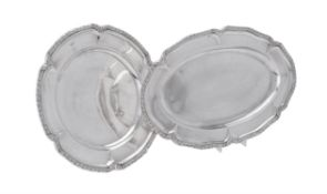 A Spanish silver coloured shaped circular dish and oval tray by A. Munoz