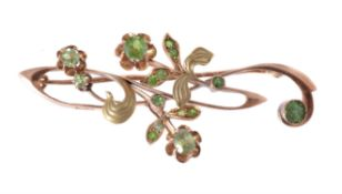 An early 20th century demantoid garnet Russian Art nouveau brooch