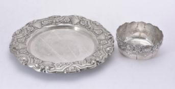 A Portuguese silver coloured shaped circular charger