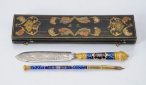 A cased 19th century enamel and gilt metal dip pen and letter opener