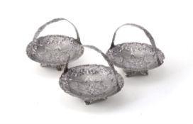 A set of three graduated silver and niello sweet baskets