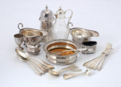 A pair of silver oval sauce boats by Asprey & Co.