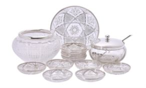 A French silver rimmed cut glass serving plate and eleven dessert plates