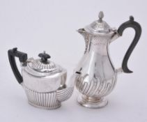 A Victorian silver baluster coffee pot by William Hutton & Sons Ltd.