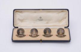 A cased set of four silver circular menu holders by Asprey & Co. Ltd.