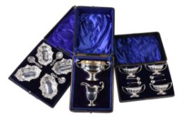 Three cased silver sets