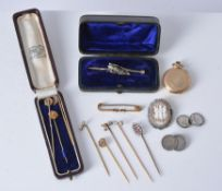 An early 20th century gold coloured fob watch and various gentleman's items