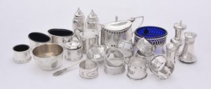 A collection of silver cruet items