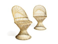 A pair of white painted wicker side chairs