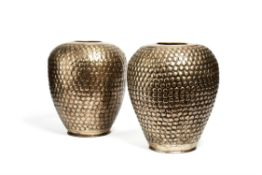 A pair of Indian silvered brass repoussé vases