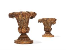 A pair of Italian gilt and pressed metal and composition vases