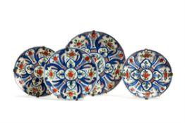 Four various Dutch Delft polychrome plates