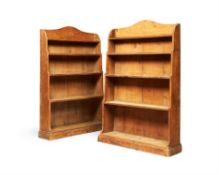 A pair of Regency pine 'waterfall' open bookcases