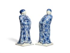 A pair of Delft type blue and white figures of Chinamen
