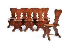 A set of eight George II mahogany hall chairs