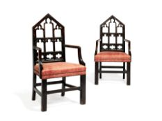 A pair of George III stained oak armchairs in Gothic taste