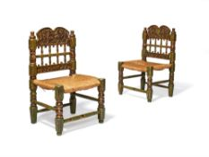 A pair of Spanish green painted and parcel giltwood side chairs