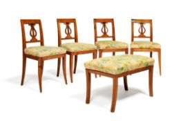 A set of four birch side chairs in early 19th Continental century style