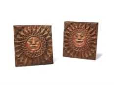 A pair of Northern European relief carved and parcel painted softwood wall plaques