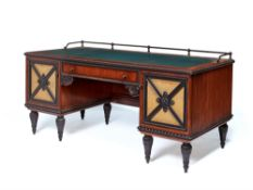 A German walnut and ebonised desk