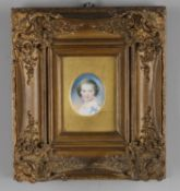 Y A small oval miniature portrait on ivory of a child