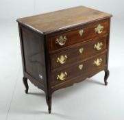 A Continental walnut chest of drawers