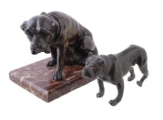 A patinated bronze model of a seated mastiff