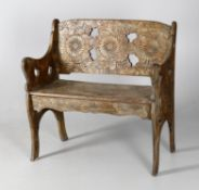 A late 19th century French carved beech bench