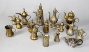 A collection of Middle Eastern brass ewers and coffee pots