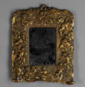 A 19th century French small gilt metal mirror