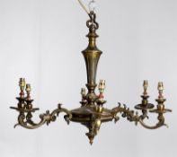 A gilt metal six light chandelier in the Louis XVI taste