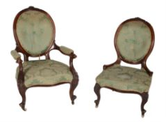 A Victorian walnut and upholstered open armchair