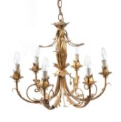 A pressed gilt metal six light chandelier- and pair of pendant lights