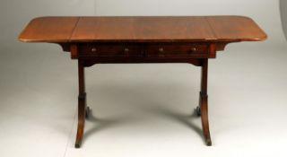 An early 19th century mahogany sofa table