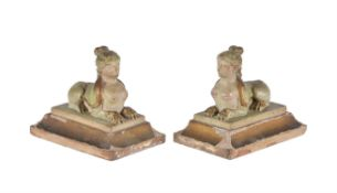 A pair of gold and green gessoed pine models of sphinxes