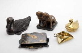 Assorted decorative items including a modern Chinese bronze duck